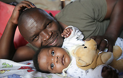South Africa Durban - 21 JUNE 2020 -Coronavirus :  Thulani Nkosi poses for a picture with his daughter Iminathi 2 months old  on father's day at Mpumalanga township in Hammarsdale <br /> PICTURE :Bongani Mbatha /African News Agency (ANA)