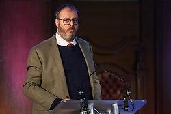 London, UK. 20th November, 2018. Patrick Foley, NAHT headteacher, addresses education staff, parents, governors, councillors, MPs and students at a  March for Education rally to protest against crises involving education funding, recruitment, staff retention and remuneration.