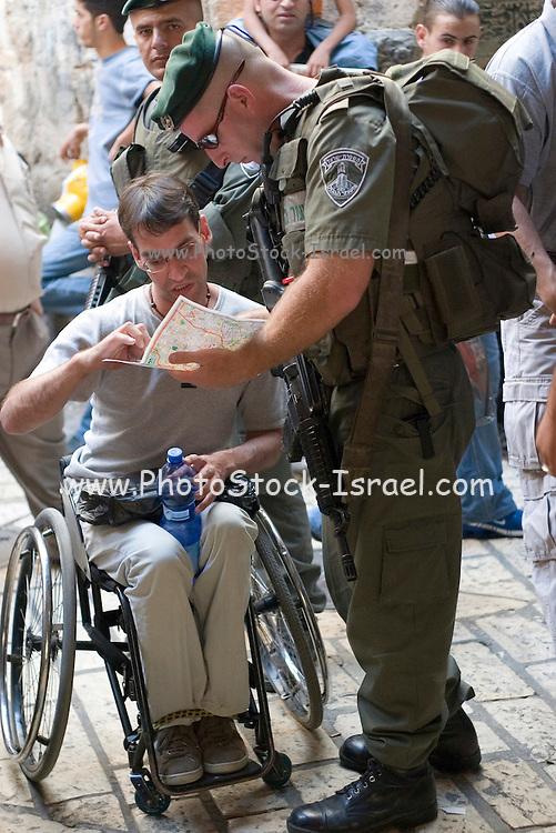 Israel, Jerusalem, border police patrol in the Muslim quarter, old city of Jerusalem helping a disabled tourist
