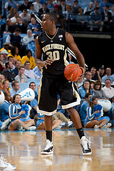 CHAPEL HILL, NC - FEBRUARY 15: Travis McKie #30 of the Wake Forest Demon Deacons dribbles the ball while playing the North Carolina Tar Heels at the Dean E. Smith Center in Chapel Hill, North Carolina. North Carolina won 64-78. (Photo by Peyton Williams/UNC/Getty Images) *** Local Caption *** Travis McKie