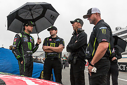 October 5, 2018 - Dover, DE, U.S. - DOVER, DE - OCTOBER 05: Kurt Busch driver of the #41 Monster Energy/Haas Automation Ford and members of his crew wait out a rain delay for qualifying for the Monster Energy NASCAR Cup Series Gander Outdoors 400 on October 05, 2018, at Dover International Speedway in Dover, DE. Qualifying was canceled after approximately a 40 minute delay. (Photo by David Hahn/Icon Sportswire) (Credit Image: © David Hahn/Icon SMI via ZUMA Press)