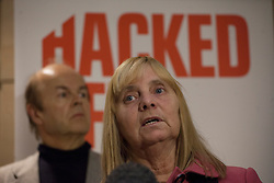 © licensed to London News Pictures. London, UK 21/11/2012. Margaret Aspinall, one of the representatives from Hacked Off, the campaign for reform of the UK's press, speaking to the media as they set to meet with Prime Minister David Cameron, Deputy Prime Minister Nick Clegg and Labour leader Ed Miliband, ahead of publication of the Leveson Inquiry's report. Photo credit: Tolga Akmen/LNP