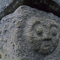 A rock carving of a face adorns the cornerstone of a temple at Kuelap, a stronghold of the pre-Incan Chachapoyan culture in Peru's Cordillera Central.
