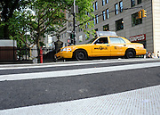 © licensed to London News Pictures. New York, USA  28/05/11. A New York Taxi cab crosses a public crossing. Photo credit should read Stephen Simpson/LNP