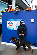 "Police dogs and workers at Moorgate station. Student march through central London to protest against rises in tuition fees and changes to higher education. The police were out in force as thousands of students marched through central London. Some 4,000 officers were on duty, as demonstrators marched peacefully in a protest against higher tuition fees and ""privatisation"" in universities. The police estimated that about 2,000 people took part in the demonstration."