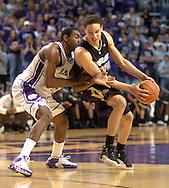Colorado guard Richard Roby (R) gets pressure from Kansas State's Akeem Wright (L) during the first half of the Wildcats 72-60 win over the Buffaloes at Bramalage Coliseum in Manhattan, Kansas, February 18, 2006.