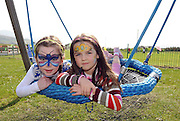 25-03-12:  Molly King (6), Ballinskelligs, Co. Kerry, and Laura Coyle (5), Caherciveen, enjoing  the sunshine and the new facilities at the official opening of the new St Finans Bay Playground at The Glen, Ballinskelligs, Co. Kerry on Sunday.  Picture: Eamonn Keogh (MacMonagle, Killarney)