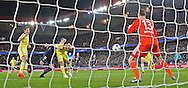 Chelsea's John Terry heads back to Chelsea's Goalkeeper Thibaut Courtois during the Champions League match between Paris Saint-Germain and Chelsea at Parc des Princes, Paris, France on 17 February 2015. Photo by Phil Duncan.