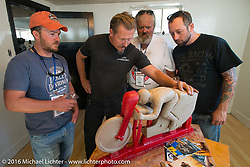 Matt McManus (L to R) with Jeff Decker, Carl Olsen and Scott Wages as Jeff explains his casting method during a hosted visit to his studio on Stage 11 (289 miles) of the Motorcycle Cannonball Cross-Country Endurance Run, which on this day ran from Grand Junction, CO to Springville, UT., USA. Tuesday, September 16, 2014.  Photography ©2014 Michael Lichter.