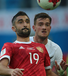 June 17, 2017 - Saint Petersburg, Russia - Alexander Samedov (L) of the Russian national football team and Deklan Wynne of the New Zealand national football team vie for the ball during the 2017 FIFA Confederations Cup match, first stage - Group A between Russia and New Zealand at Saint Petersburg Stadium on June 17, 2017 in St. Petersburg, Russia. (Credit Image: © Igor Russak/NurPhoto via ZUMA Press)