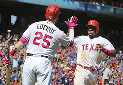 May 14, 2017 - Arlington, TX, USA - Texas Rangers Jonathan Lucroy (25) high fives Elvis Andrus (1), who scored on a single by Nomar Mazara, to take the lead against the Oakland Athletics in the seventh inning on Sunday, May 14, 2017 at Globe Life Park in Arlington, Texas. (Credit Image: © Richard W. Rodriguez/TNS via ZUMA Wire)