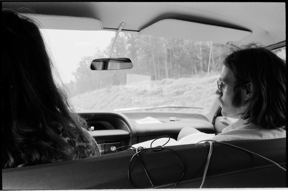 Ray driving, Fred front seat passenger. On the Road somewhere in Pennsylvania heading west in 1973.