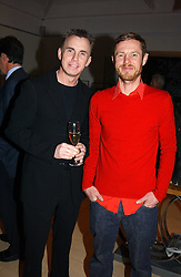 Left to right, GARY RHODES and MR TOM CONRAN at a party to celebrate a book of work by artist Jack Vettriano held at The Bluebird Club & Dining Room, 350 Kings Road, London on 7th December 2004.<br /><br />NON EXCLUSIVE - WORLD RIGHTS