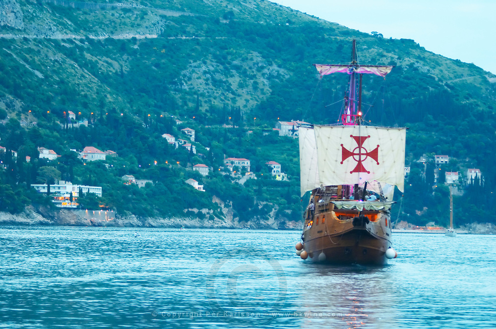 The Karaka 16 century galleon replica boat in the old harbour in evening blue light Dubrovnik, old city. Dalmatian Coast, Croatia, Europe.