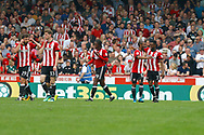 Brentford players celebrate a goal from Brentford Midfielder Florian Jozefzoon (7) (score 2-1) during the EFL Sky Bet Championship match between Brentford and Queens Park Rangers at Griffin Park, London, England on 21 April 2018. Picture by Andy Walter.