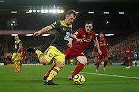 Football - 2019 / 2020 Premier League - Liverpool vs. Southampton<br /> <br /> Southampton's James Ward-Prowse under pressure from Liverpool's Andy Robertson<br /> <br /> Colorsport / Terry Donnelly