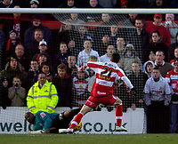 Photo: Jed Wee.<br />Doncaster Rovers v Swansea City. Coca Cola League 1.<br />17/12/2005.<br />Doncaster's Michael McIndoe sends the spot kick under Swansea goalkeeper Willy Gueret (L).