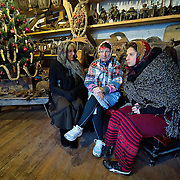 VENICE, ITALY - JANUARY 06:  Women dressed as Witches get ready to leave the Arzana rowing association for the Befana Regata on January 6, 2011 in Venice, Italy.  In Italian folklore, Befana is an old woman who delivers gifts to children throughout Italy on Epiphany January 6 iin a similar way to Saint Nicholas or Santa Claus