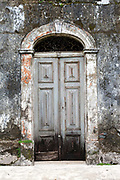 The door of an abandoned house, Principe, Sao Tome and Principe<br /> Sao Tome and Principe, are two islands of volcanic origin lying off the coast of Africa. Settled by Portuguese convicts in the late 1400s and a centre for slaving, their independence movement culminated in a peaceful transition to self government from Portugal in 1975.