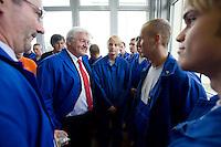 29 AUG 2008, EISENHUETTENSTADT/GERMANY:<br /> Frank-Walter Steinmeier (2.v.L.), SPD, Bundesaussenminister, und Matthias Platzeck (L), SPD, Ministerpraesident Brandenburg, im Gespraech mit Auszubildenden, waehrend dem Besuch des Stahlwerks ArcelorMittal Eisenhuettenstadt, der ehem. Eko Stahl, im Rahmen von Steinmeiers Sommerreise durch Brandenburg<br /> IMAGE: 20080829-01-034<br /> KEYWORDS: Eisenhüttenstadt, Blaumann