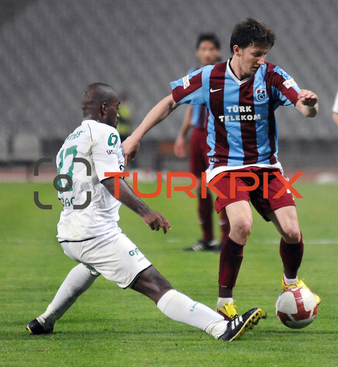 Trabzonspor's Hrvoje CALE (R) and Denizlispor's Douglas D BRAGA (L) during their Turkish superleague soccer match Trabzonspor between Denizlispor at the Avni Aker Stadium in Trabzon Turkey on Monday, 10 May 2010. Photo by TURKPIX