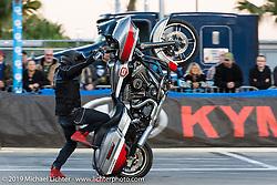 Cole Freeman of the Ill Conduct Stunt Team performs on the break of the American Flat Track TT at Daytona International Speedway during Daytona Bike Week. Daytona Beach, FL. USA. Thursday March 15, 2018. Photography ©2018 Michael Lichter.