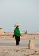 Woman carrying a bag on her head, Hadibu, Socotra, Yemen