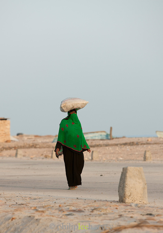 Woman carrying a bag on her head, Hadibu, Socotra, Yemen