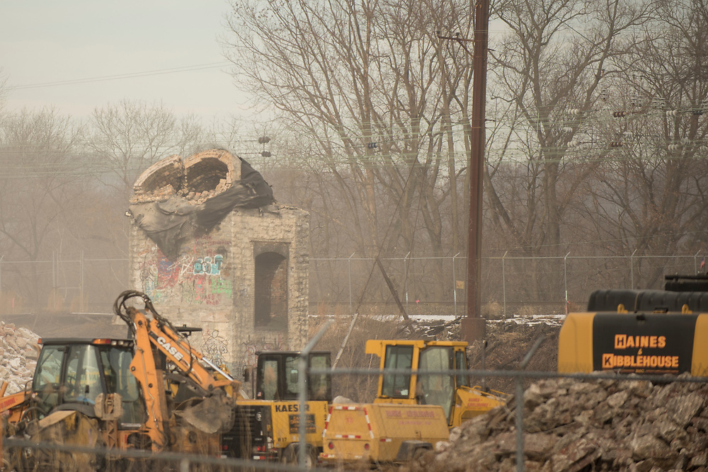 """The towers from the disused Sonoco Paper Mill in Downingtown, Pennsylvania are demolished by explosives. The former paper mill will make way for retail and residential spacing as well as a potential new train station for the area. <br /> <br /> In April of 2016 Donald Trump passed this building in his motorcade following a campaign stop and caused outcry in the area, by tweeting a picture of the disused building saying """"Passing what was once a vibrant manufacturing area in Pennsylvania. So sad!"""" followed by his """"Make America Great Again"""" campaign slogan.<br /> <br /> Downingtown, Pa. January 19, 2018. <br /> <br /> By Jack Megaw.<br /> <br /> <br /> <br /> www.jackmegaw.com<br /> <br /> jack@jackmegaw.com<br /> @jackmegawphoto<br /> [US] +1 610.764.3094<br /> [UK] +44 07481 764811"""
