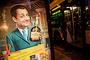 """A Portuguese company advertises its liquor brand using digital composed images of German Chancellor Angela Merkel and French President Nicolas Sarcozy holding a Licor Beirão bottle, it can be read in the muppie among other things, """"Dear Nicolas. Portugal is giving its best. Happy Holidays."""" , in Lisbon, Portugal. 27/12/2011 IN SALES IN PORTUGAL"""