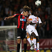 Genclerbirligi's (L) Jimmy Durmaz and Galatasaray's (R) Dany Achille Nounkeu during their Turkish Superleague soccer match Genclerbirligi between Galatasaray at the 19 Mayis stadium in Ankara Turkey on Friday 19 October 2012. Photo by TURKPIX