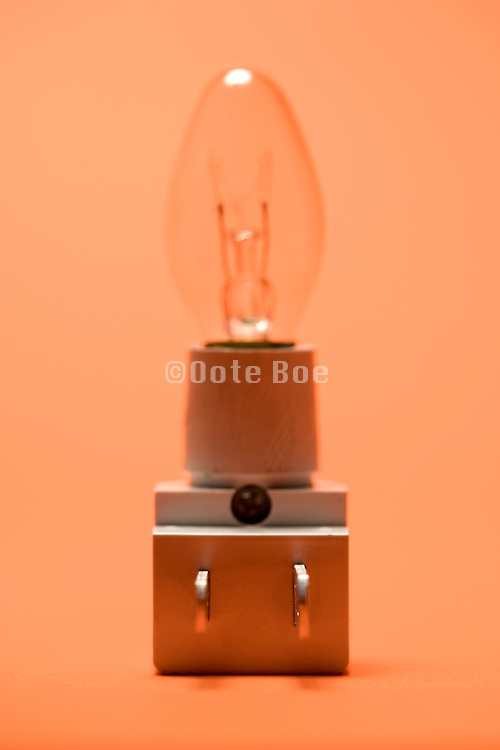 a plug in little night light partly in focus