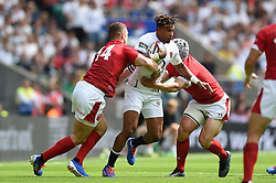 Anthony Watson of England takes on the Wales defence - Mandatory byline: Patrick Khachfe/JMP - 07966 386802 - 11/08/2019 - RUGBY UNION - Twickenham Stadium - London, England - England v Wales - Quilter International