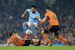 24th October 2017 - Carabao Cup (4th Round) - Manchester City v Wolverhampton Wanderers - Ilkay Gundogan of Man City skips over a challenge from Jack Price of Wolves (L) and Danny Batth of Wolves - Photo: Simon Stacpoole / Offside.