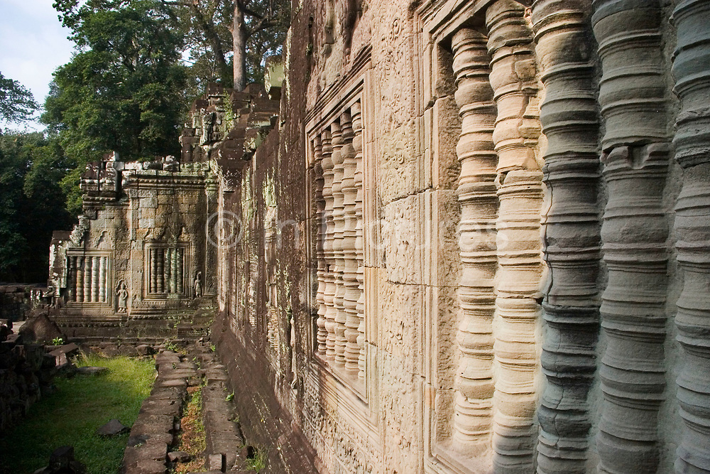 Intricate carvings at Preah Khan, which was built and used by Jayavarman VII. Living there while Angkor Thom was being reconstructed. Once having the role of monastery and university to many thousands, it then became an inter-denominational temple for Buddha, Shiva and Vishnu and the main deity Lokesvara (plus another 282 gods). Today it is in a state of semi-collapse, lichen and moss covered, and with the jungle trees encroaching it's walls.