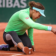 PARIS, FRANCE May 25. Naomi Osaka of Japan slips while practicing on CourtSimonne Mathieu in preparation for the 2021 French Open Tennis Tournament at Roland Garros on May 25th 2021 in Paris, France. (Photo by Tim Clayton/Corbis via Getty Images)