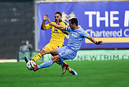 Oxford United midfielder Ricky Holmes (12) tackled by Coventry City midfielder Michael Doyle (8)  during the EFL Sky Bet League 1 match between Oxford United and Coventry City at the Kassam Stadium, Oxford, England on 9 September 2018.