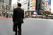 businessman crossing Hachiko intersection at Shibuya station