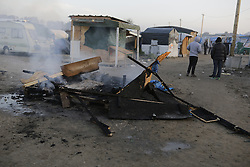 October 25, 2016 - Calais, Nord-Pas-de-Calais-Picardie, France - A hut has been burnt at night, to keep refugees warm. A little less than 2000 refugees are expected to be disbursed from the Jungle to different areas in France on the 2nd day of the eviction of the Jungle in Calais. It is also expected that the demolition of the camp will start. (Credit Image: © Michael Debets/Pacific Press via ZUMA Wire)