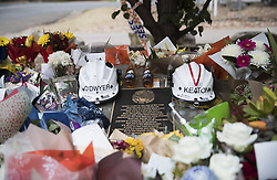 December 21, 2019, New South Wales, Australia: Flowers put beside the helmets of two volunteer firefighters who died in combat against the bushfire outside the Horsley Park Rural Fire Service (RFS) in New South Wales. The New South Wales (NSW) government in Australia once again declared a state of emergency because of the devastating bushfire on Thursday. (Credit Image: © Bai Xuefei/Xinhua via ZUMA Wire)