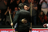 Ronnie O'Sullivan (Eng) consoles Liang Wenbo (Chn) after The Rocket beat the Chinese player by 6-5. Ronnie O'Sullivan v Liang Wenbo, 1st round match at the Dafabet Masters Snooker 2017, day 1 at Alexandra Palace in London on Sunday 15th January 2017.<br /> pic by John Patrick Fletcher, Andrew Orchard sports photography.