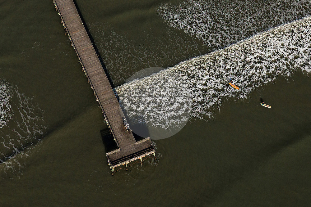 Aerial view of the pier and stand up paddle boarders in Isle of Palms, SC.