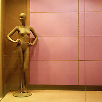 The colors and mannequin in this bare shop window at Benetton caught my attention; Time Warner Center, New York City.