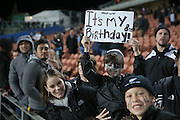 Birthday boy Mason Carter had a sign after the third rugby test between the All Blacks and England played at Waikato Stadium in Hamilton during the Steinlager Series - All Blacks v England, Hamiton, 21 June 2014<br /> www.photosport.co.nz