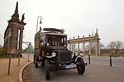 An old restored German bus, now used for tourist excursions, seen on the Glienicke bridge, Potsdam, Brandenburg, Germany.