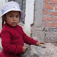 A girl posing near her house in Cabanaconde