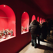 VERONA, ITALY - DECEMBER 04:  Visitors at exhibition  of nativity scenes from all over the world inside the passage ways of the Roman Arena. on December 4, 2010 in Verona, Italy. Christmas markets, fairs, lights and nativity scenes fill Northern Italian cities and villages from December through January 6.