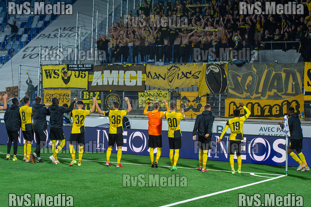 LAUSANNE, SWITZERLAND - SEPTEMBER 22: Team BSC Young Boys celebrates their victory with fans during the Swiss Super League match between FC Lausanne-Sport and BSC Young Boys at Stade de la Tuiliere on September 22, 2021 in Lausanne, Switzerland. (Photo by Monika Majer/RvS.Media)