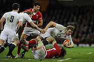 England's Joe Launchbury is tackled by Adam Jones of Wales. RBS Six nations championship 2013, Wales v England at the Millennium stadium in Cardiff , South Wales on Saturday 16th March 2013. pic by Andrew Orchard, Andrew Orchard sports photography,