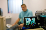 A prisoner records a video mesage for his family. HMP Wandsworth, London, United Kingdom